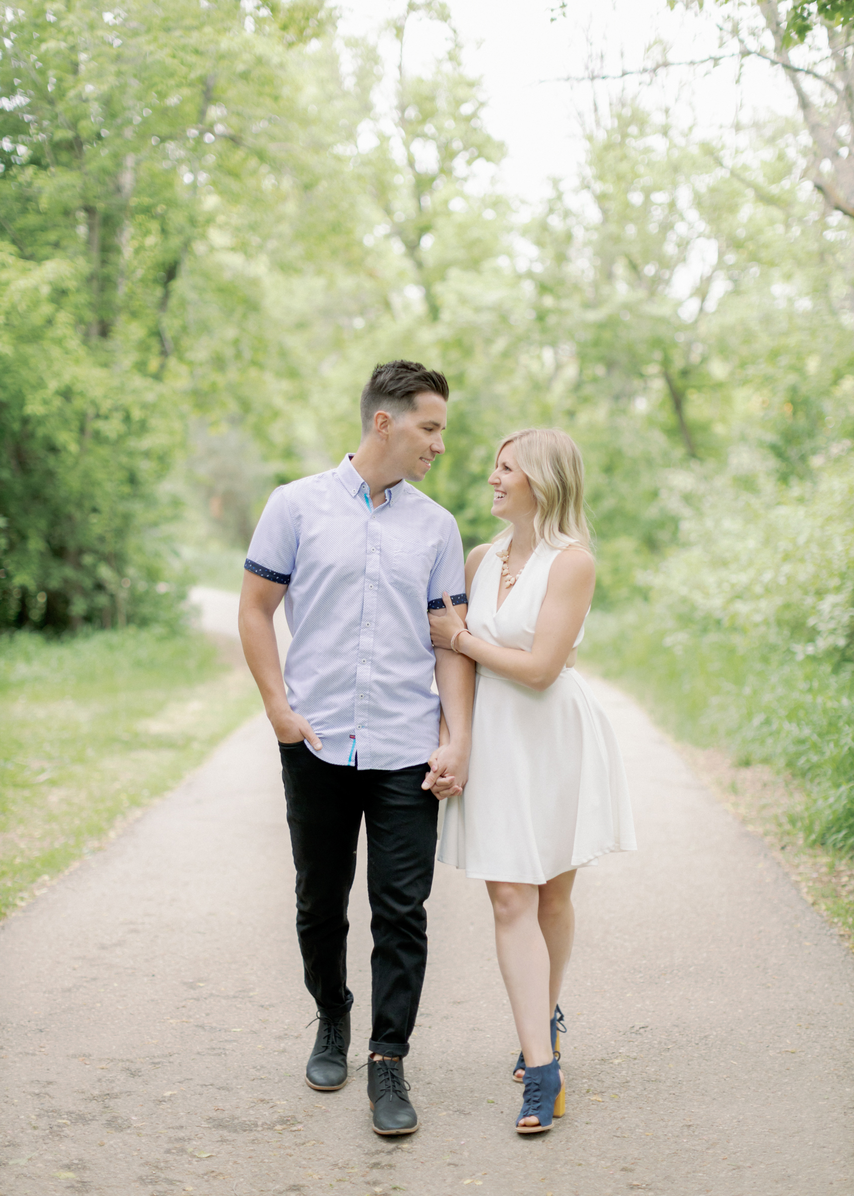 tanner and alyssa walking during engagement session