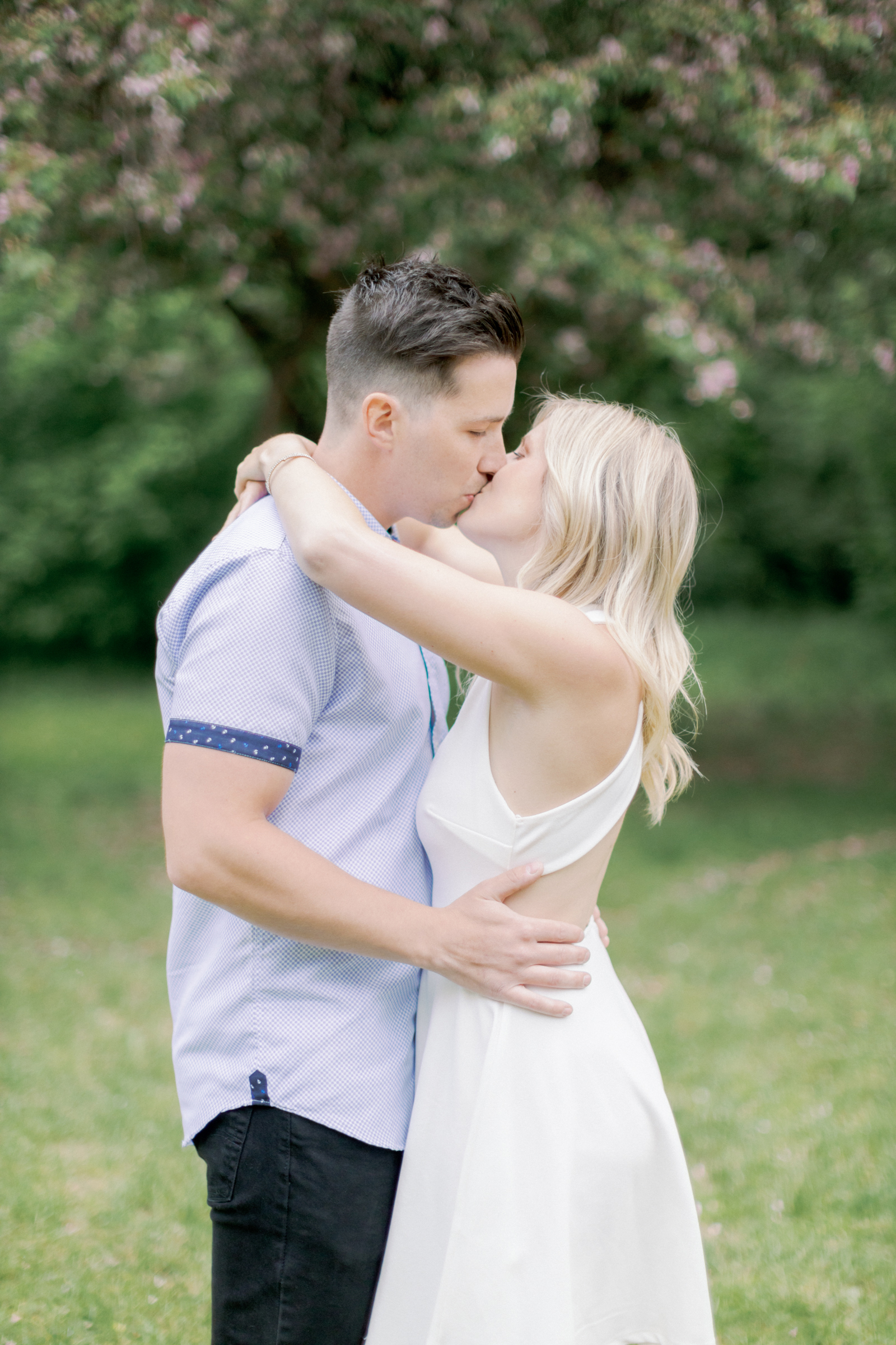 tanner and alyssa kissing during engagement session