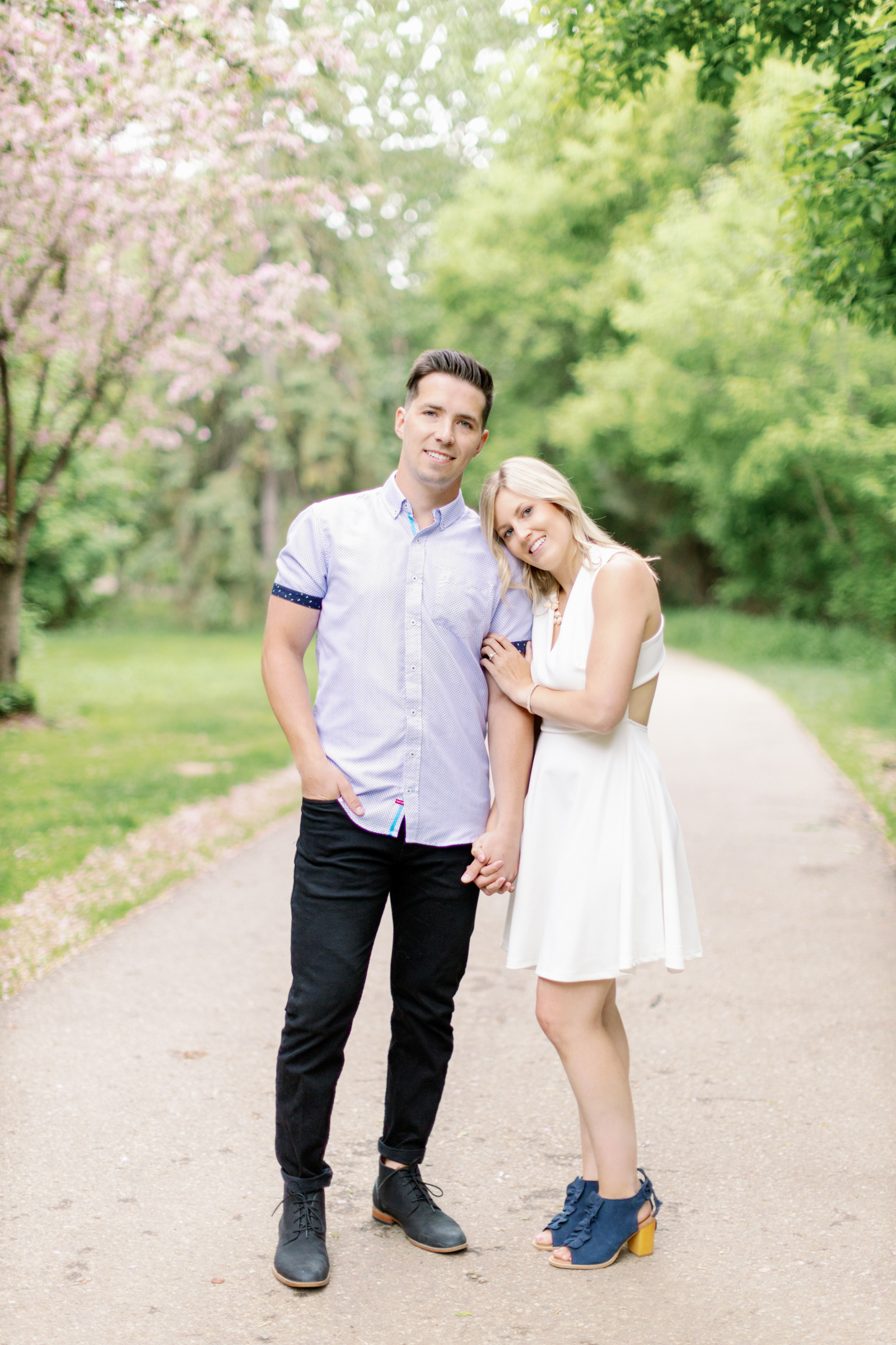 Lean on his shoulder during engagement session